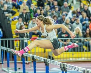 Abby Stultz hurdles to her 2015 2A State title.