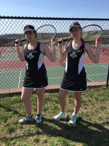 Doubles team Kylie Schade and Caroline Smith pose for a picture before a match.